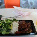 Chicken, Rice, Salad and fresh orange juice.