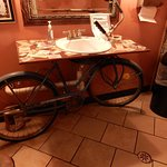 The restroom features a bicycle