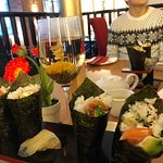 The beautiful flora tea in a glass as well as salmon avocado handrolls
