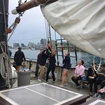 Hoisting the sail on a glorious summer evening on Tall Ship Kajama