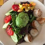scallops over greens and mango salsa