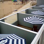 View of first floor's enclosed patios along the beach boardwalk (shot from the 2nd floor balcony