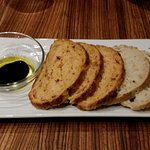 Selection of breads with olive oil & balsamic oil.