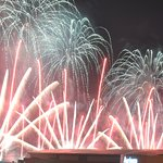 """Fireworks, viewed from the grandstand. Locals go to """"Scotsman's Hill"""" to see them for free."""