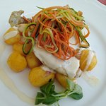 chicken breast with cheese sauce, potatoes and vegetables