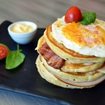 The Mountain of Doom pancakes with turkey, bacon, cream cheese, mayonaise and an egg.