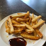 Wonderful crisp french fries, coated in seasoned salt -- perfect for dipping in the BBQ sauce.