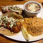 Baja fish tacos with fried pinto beans and rice