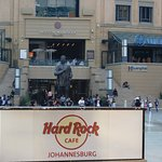 Hard Rock Sign with Nelson Mandela Statue in Background