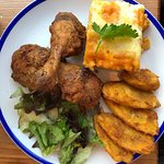 Fried chicken with macaroni pie and plantain.