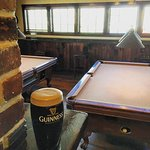 Guinness on tap and two pool table for entertainment.