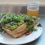 Avocado toast with arugula and pickled onions