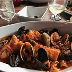 Authentic Cioppino stew -- served with linguine but pay a few dollars extra for Zoodles and feel