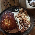 Arrechera taco with Itacate cheese on top and a Carnitas taco!