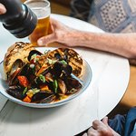 Mussels tossed with tomato, garlic, white wine and shallots & crusty bread