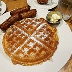 Waffle with a side of sausage links - locally sourced maple syrup