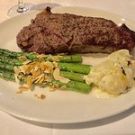 Prime Strip, Asperagus with roasted almonds and Uptown Del's Potato