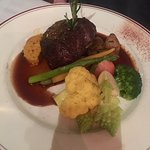 Beef Tenderloin with a side of vegetables.