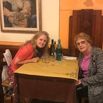 Mom and me in the table I sat in almost ten years ago!