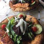 Salad on pizza crust.. unique and delicious