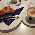 Breakfast latte and croissant