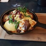 poutine which was duck confit, poached egg, caramelized onion, russet potato, cheese curds.