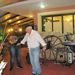 The owner giving us a taste of Greek dancing