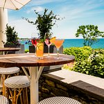 Sip cocktails on our outdoor terrace while enjoying stunning garden and oceanfront views.