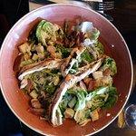 Chicken Caesar salad: romaine lettuce, garlic & herb croutons, house dressing & parmesan shaving