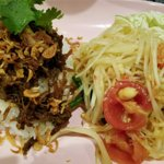 Khao Man Som Tam. Green papaya salad with coconut rice, shredded pork, fried shallots and cilant