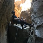 Rappelling a slot canyon in Zion National Park