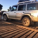 Our Landcrusier on a raft to cross a river!