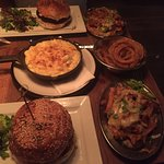 our feast before, burger, chilli cheese fries, onion rings and mac n cheese