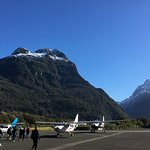 the landing strip and two glenorchy planes that took a group of about 12 people to the milford s