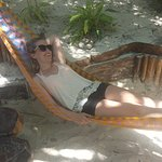 We couldn't leave without her taking a photo in one of the hammocks!