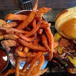 Southern Charm Burger with Sweet Potato Fries.