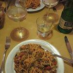 Primi piatti tagliolini with radicchio and speck and tomatoes.