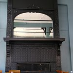 Dining room fireplace and large mirrors