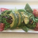 Today's special salad including fresh tomatoes and walnuts with avocado added.