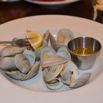 More than a dozen steamed clams