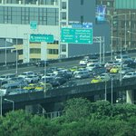 Elevated toll road from city to airport provides alternative transport. Be aware of congestion.