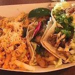 Left the days carnivore taco crispy fried calamari, blacken shrimp street taco, and the Her