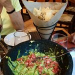 homemade guacamole with baked tortilla chips