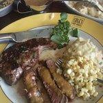 Cowboy Rib Eye with peppercorn sauce, creamed corn(special) & garlic mashed potatoes.