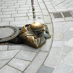 Bratislava - Viktor Hulik created Cumil - Statue of Man at Work - a parody on the Communist days