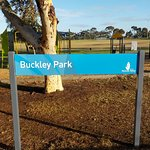 Park sign, with playground behind