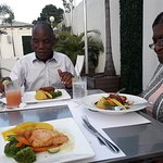 The salmon was moist and nicely flavoured served with sweet potato/mash potato