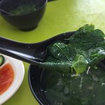 The soup of veg that accompanies your order of pan mee.