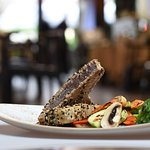 Steak tuna on a plate with sesam,  sauce Teriyaki and Grilled vegetables