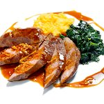 Duck fillet with mousse from sweet potatoes, steamed spinach and braten juice sauce.